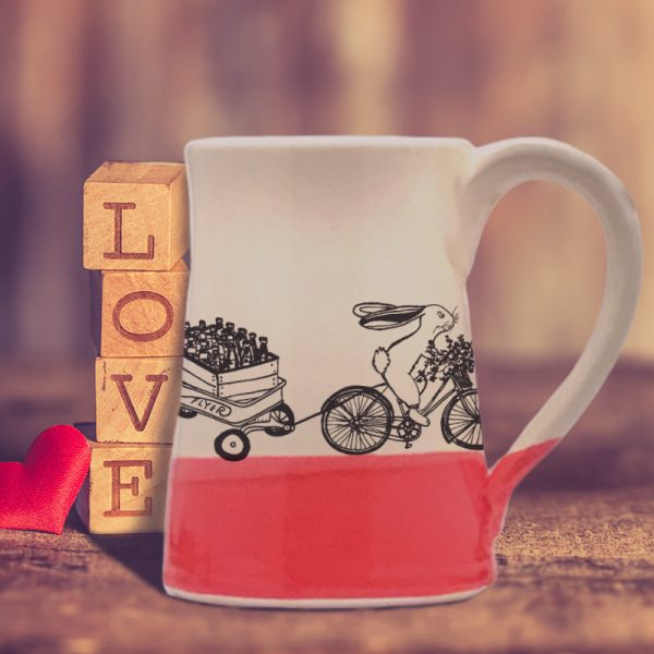Large coffee mug handmade by hedgehogs with an illustration of yet another Ale on Wheels delivery person. This rabbit is new and not particularly fast. Red accent color