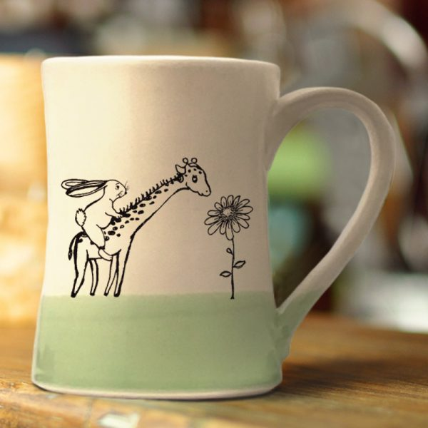 Large mug, handmade and illustrated by Darn Pottery hedgehogs, appears to have a rabbit riding a giraffe. Surely, this can't be happening. Green accent color