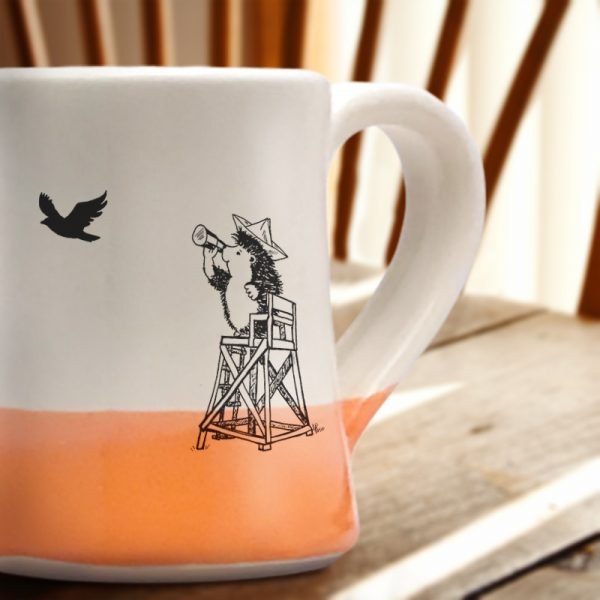 The most important moment in all of American history is portrayed on this handmade mug: vigilant hedgehog at the beach looking for the British armada. Coral accent color.