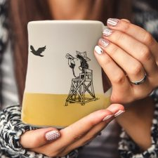 The most important moment in all of American history is portrayed on this handmade mug: vigilant hedgehog at the beach looking for the British armada. Gold accent color.