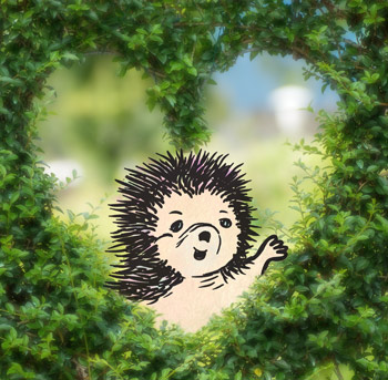Darnit the hedgehog waving through a heart shaped hole in a hedge