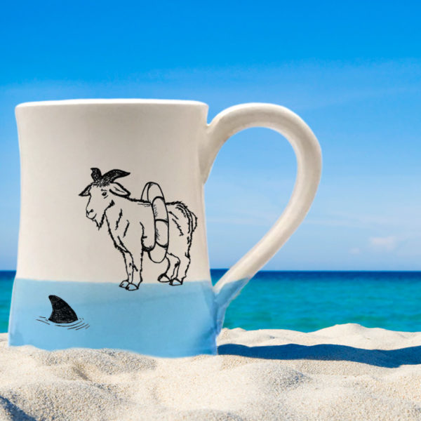 Handmade coffee mug with a drawing of a goat reconsidering his impulsive decision to swim with the sharks. Blue accent color.