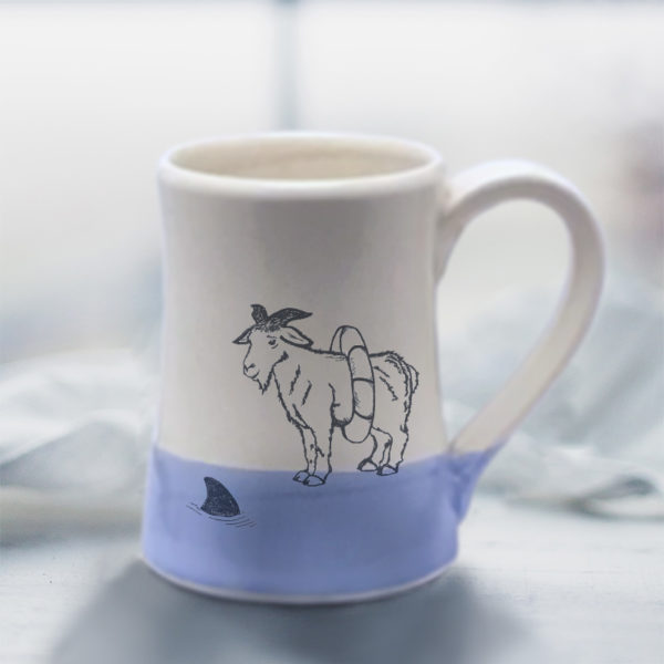 Handmade coffee mug with a drawing of a goat reconsidering his impulsive decision to swim with the sharks. Lavender accent color.