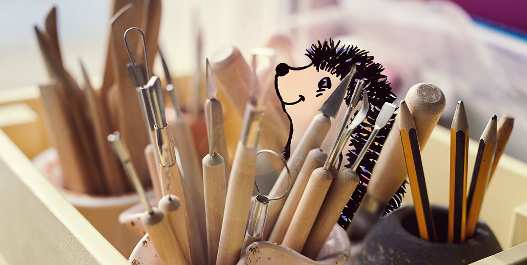 Mischevious hedgehog hiding in tools used for making handmade pottery at Darn Pottery
