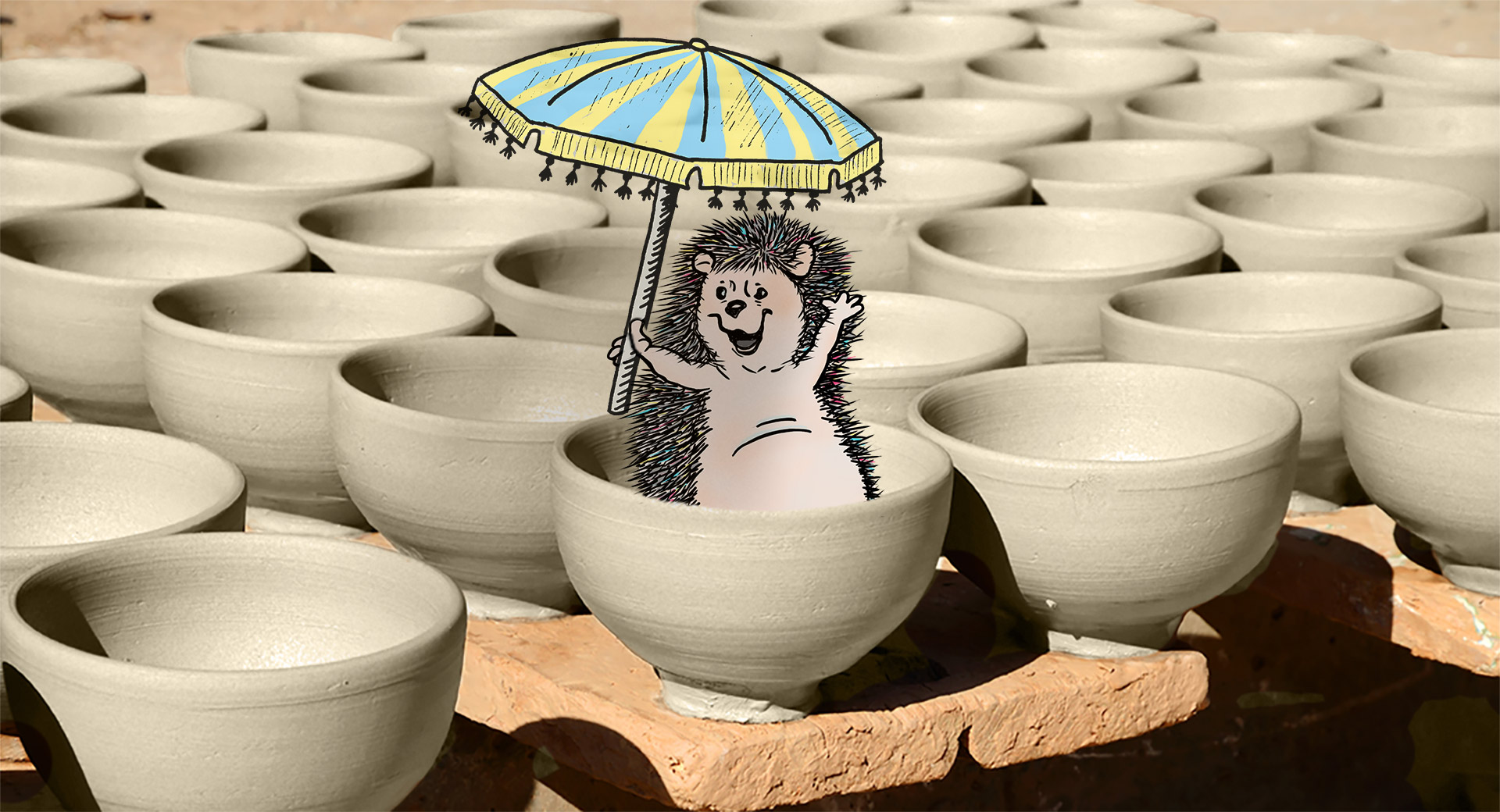 Hedgehog supervising handmade pottery bowls drying in the bright sun
