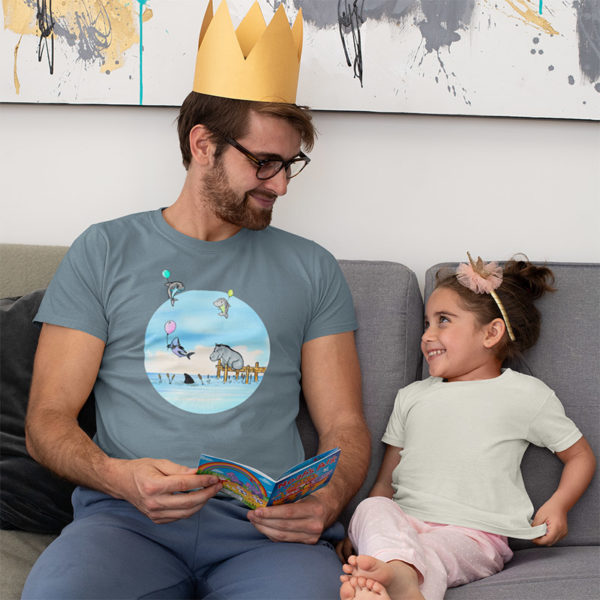 Man wearing a graphic T-shirt with an original drawing of a hippo watching baby sharks float by on balloons