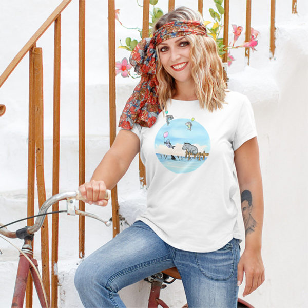 Woman wearing a graphic T-shirt with an original drawing of a hippo watching baby sharks float by on balloons
