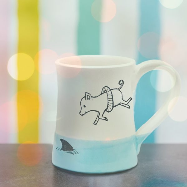 Handmade coffee mug with illustration of a piglet in a life ring bravely diving into shark infested waters. Light blue accent color. Made by hedgehogs in the Blue Ridge Mountains.