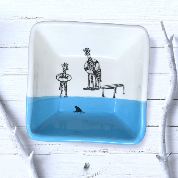 square blue bowl with drawing of giraffes in life preservers