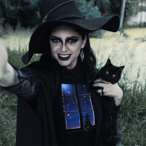 Photograph of witchy woman wearing original graphic tshirt with cat