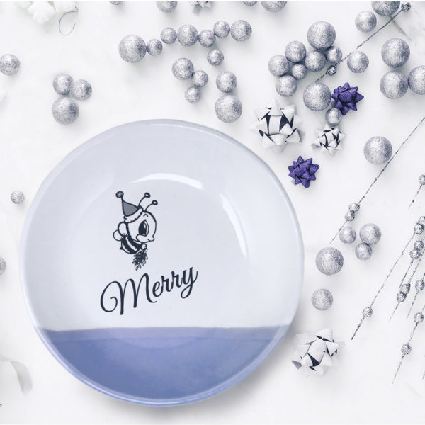 Handmade salad plate with drawing of a bee in a Santa hat and the word Merry. Lavender accent color