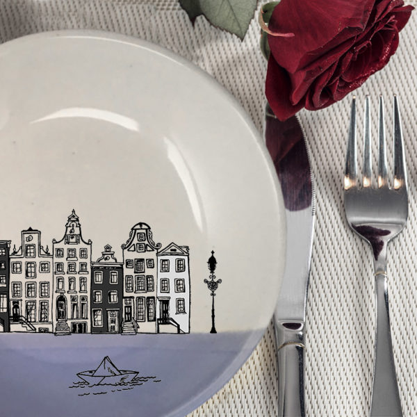 This ceramic plate is handmade by hedgehogs at Darn Pottery and has a drawing of Amsterdam canal houses and a little paper boat. Lavender accent color