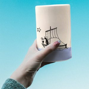 A handmade tumbler with a drawing of a hedgehog on a sailboat, probably plotting a daring exploit. Lavender accent color.