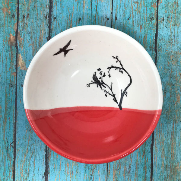 small bowl with drawing of birds. red accent color