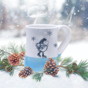 Handmade coffee mug with a drawing of a hedgehog ice skating and looking dapper. Blue accent color.