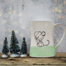 Handmade coffee mug with illustration of a little mouse in a Santa hat. Green accent color