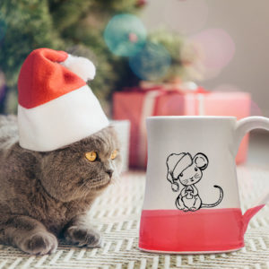 Handmade coffee mug with illustration of a little mouse in a Santa hat. Red accent color