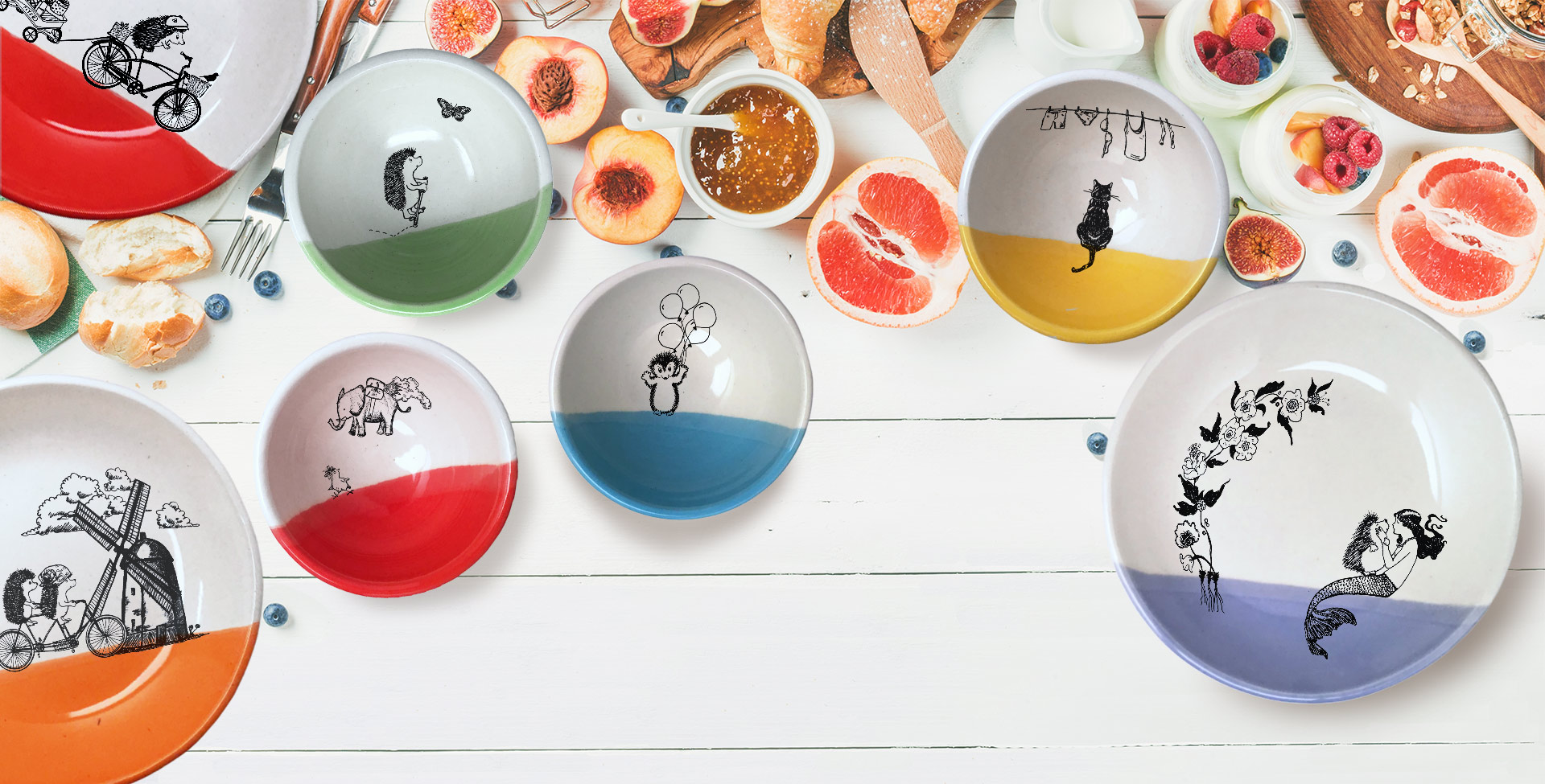 A collection of Darn Pottery's bowls and plates on a colorful table