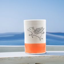 A lovely ceramic tumbler handmade by hedgehogs and illustrated with a really cute flying pig. Coral accent color.