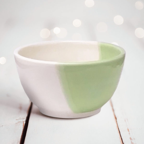 Side view of Darn Pottery Soup Bowl. Green accent color.