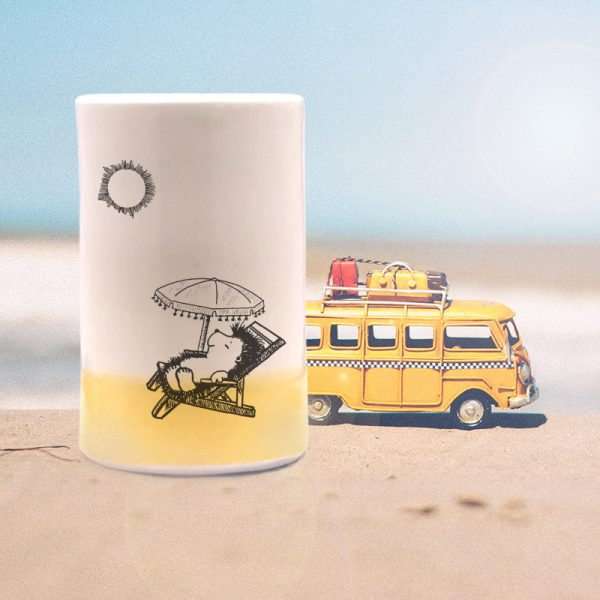 This handmade ceramic tumbler is for everyone who dreams in colors borrowed from the sea. Featuring a drawing of happy mama hedgehog relaxing under a beach umbrella. Gold accent color.
