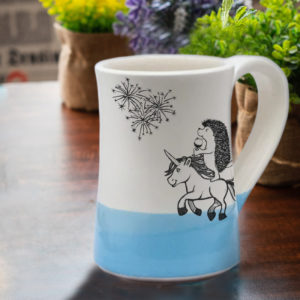 Handmade coffee mug with hedgehog on unicorn drinking wine and watching fireworks