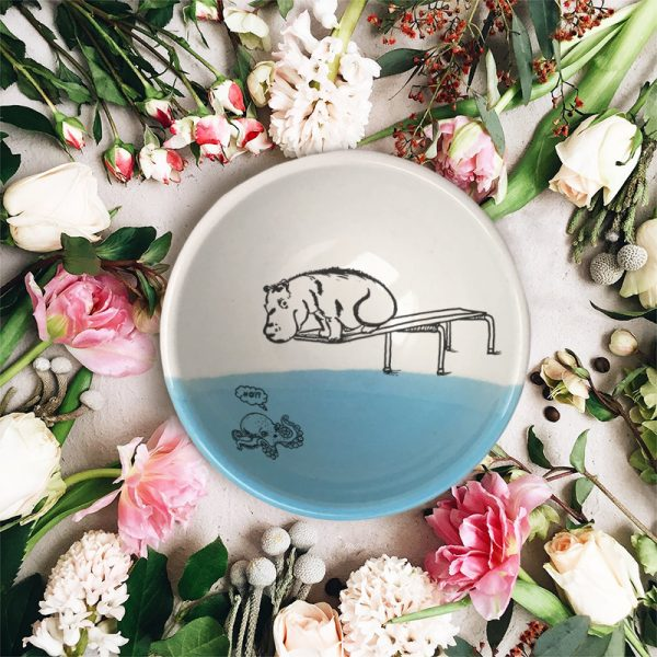 A hippo on a diving board. A little kracken understandably nervous beneath him. These emotions and more are indelibly captured on this handmade ceramic bowl. Blue accent color