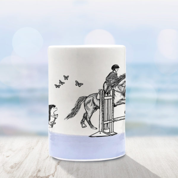Handmade tumbler with drawing of hedgehog on a pogo stick and a horse jumping