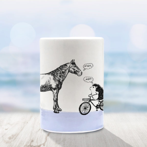 handmade tumbler with drawing of horse and hedgehog on a bike. Lavender accent color