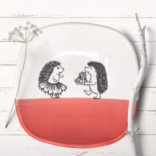 square salad plate with drawing of hedgehog carrying gifts to a lady hedgehog
