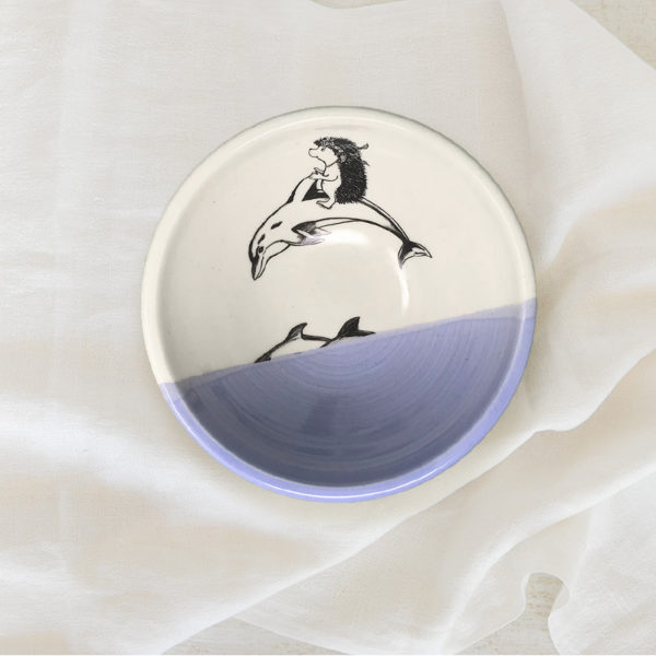 lavender soup bowl with drawing of hedgehog riding a dolphin