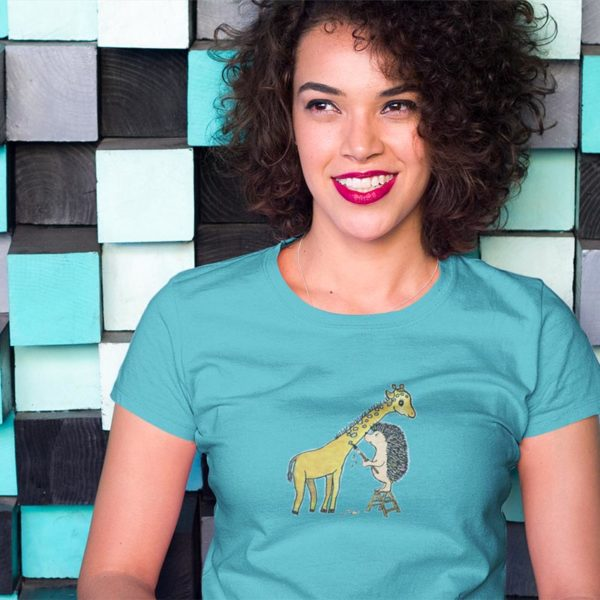 Model wearing a graphic Tshirt illustrated with original Darn Pottery artwork of hedgehog painting spots on a giraffe