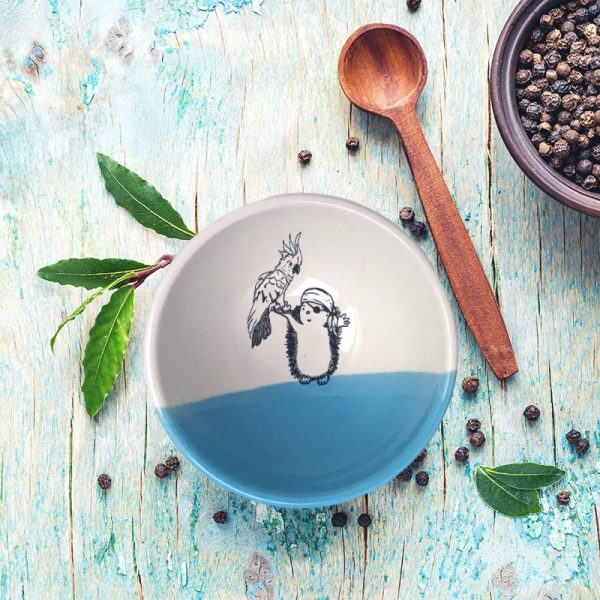 No pirate is complete without a sidekick. The parrot and the hedgehog pirate are a great team and are featured in the drawing on this handmade ceramic bowl. Blue accent color.