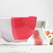 Side view of Darn Pottery Soup Bowl. Red accent color.