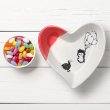 Handmade ceramic heart-shaped dish with drawing of hedgehog and dodo. Red accent color