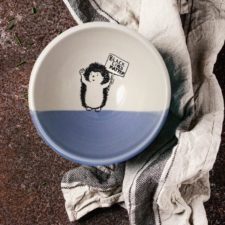 Handmade ceramic soup bowl with a drawing of a hedgehog holding a Black Lives Matter resistance sign. Lavender accent color.
