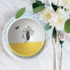Handmade ceramic soup bowl with a drawing of a hedgehog holding a Feminist AF sign. Gold accent color.