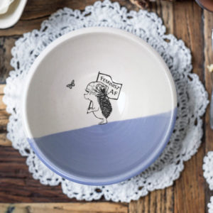 Handmade ceramic soup bowl with a drawing of a hedgehog holding a Feminist AF sign. Lavender accent color.