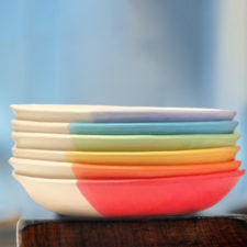 Stack of colorful salad plates made by Darn Pottery