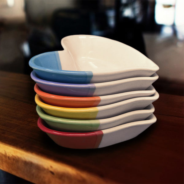 Stack of handmade heart-shaped dishes
