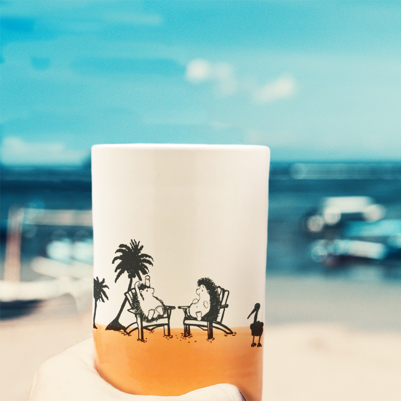 Capturing that classic pastime of reminiscing about space aliens at the beach, this handmade ceramic tumbler also does a great job of holding various tasty liquids. Coral accent color.