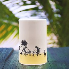 Capturing that classic pastime of reminiscing about space aliens at the beach, this handmade ceramic tumbler also does a great job of holding various tasty liquids. Gold accent color.