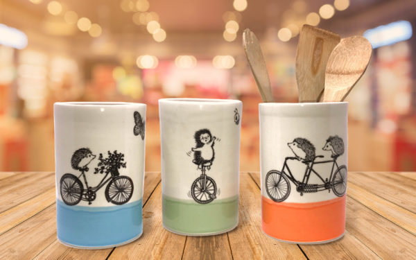Large utensil holders with drawings of hedgehogs on bikes