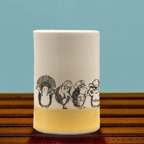 A handmade tumbler with an action drawing of the Village Hedgehogs, a late 70's singing phenomenon. A musical tour de force, they eclipsed both ABBA and the Jackson 5. Gold accent color.