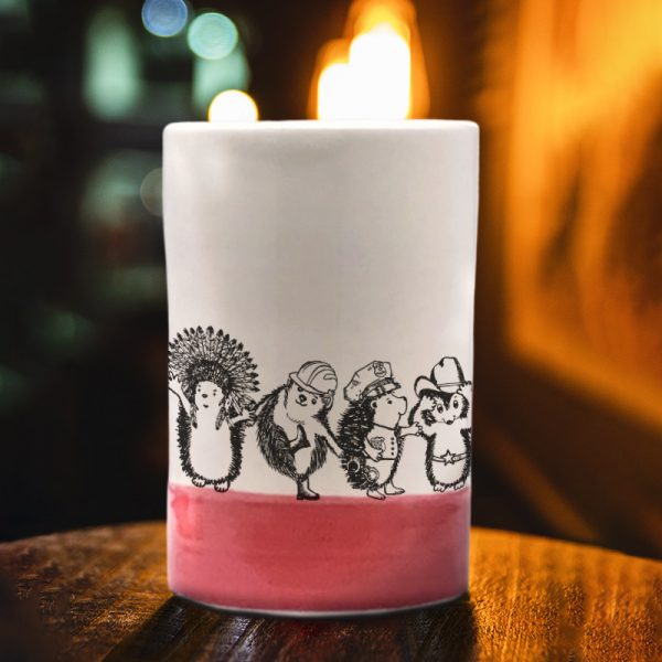 A handmade tumbler with an action drawing of the Village Hedgehogs, a late 70's singing phenomenon. A musical tour de force, they eclipsed both ABBA and the Jackson 5. Red accent color.